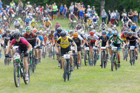 STOCKHOLM, SWEDEN - JUNE 11, 2017: Large group of fighting mountainbike cyclists i cycling uphill at Lida Loop Mountainbike Race. June 11, 2017 in Stockholm, Sweden