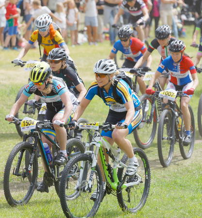 STOCKHOLM, SWEDEN - JUNE 11, 2017: Large group of fighting mountain bike cyclists i cycling uphill at Lida Loop Mountain bike Race. June 11, 2017 in Stockholm, Sweden Editöryel