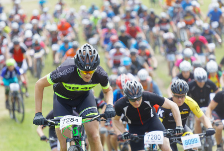 STOCKHOLM, SWEDEN - JUNE 11, 2017: Lots of mountain bike cyclist struggling in a steep uphill at Lida Loop Mountain bike Race. June 11, 2017 in Stockholm, Sweden