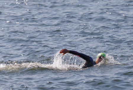 bath: STOCKHOLM - AUG 26, 2017: Female swimmer stroking her arm in the water in the Womens ITU World Triathlon series event August 22, 2017 in Stockholm, Sweden