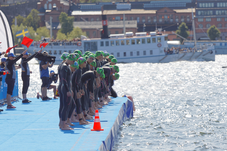 STOCKHOLM - AUG 26, 2017: The female swimming competitors waiting for the start signal in the Womens ITU World Triathlon series event August 22, 2017 in Stockholm, Sweden