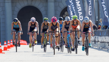 Group of female triathlete cyclists in the Womens ITU World Triathlon series event Editorial