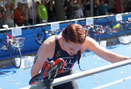 STOCKHOLM - AUG 26, 2017: Triathlete Lucy Hall (GBR) change clothes  in the transition zone in the Womens ITU World Triathlon series event August 26, 2017 in Stockholm, Sweden