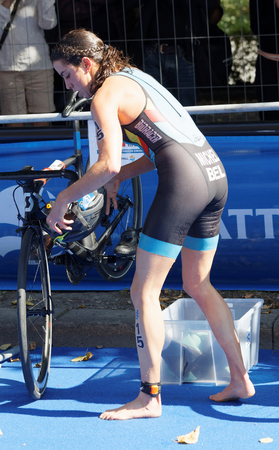 STOCKHOLM - AUG 26, 2017: Triathlete Claire Michel (BEL) fixing the helmet in the transition zone in the Womens ITU World Triathlon series event August 26, 2017 in Stockholm, Sweden Editorial