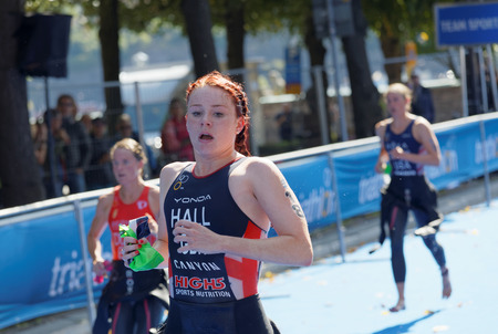 STOCKHOLM - AUG 26, 2017: Triathlete Lucy Hall (GBR) and competitors running in the transition zone in the Womens ITU World Triathlon series event August 26, 2017 in Stockholm, Sweden
