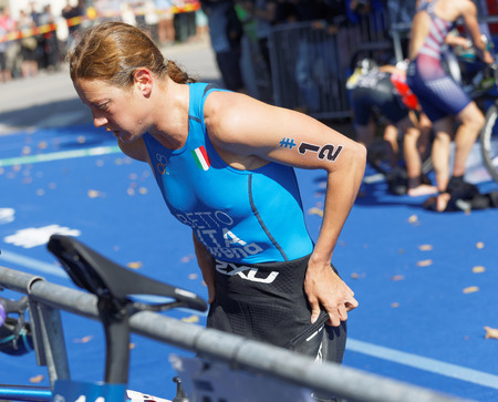 STOCKHOLM - AUG 26, 2017: Triathlete  Alice Betto (ITA) change clothes  in the transition zone in the Womens ITU World Triathlon series event August 26, 2017 in Stockholm, Sweden
