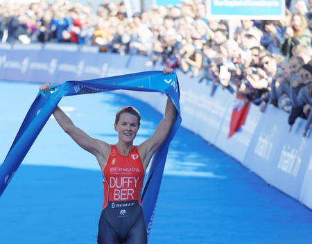 STOCKHOLM - AUG 26, 2017: Smiling triathlete Flora Duffy winning  in the Womens ITU World Triathlon series event August 26, 2017 in Stockholm, Sweden