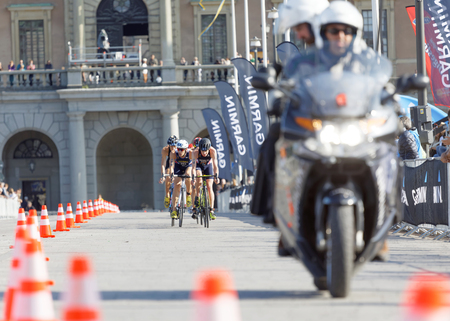 elite: STOCKHOLM - AUG 26, 2017: Jonathan Brownlee and group of male triathlete cyclists in the Mens ITU World Triathlon series event August 26, 2017 in Stockholm, Sweden