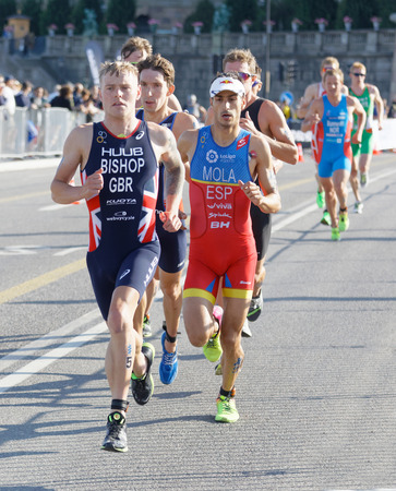 elite: STOCKHOLM - AUG 26, 2017: Group of running triathletes, Bishop (GBR), Mola (ESP) and competitors in the Mens ITU World Triathlon series event August 26, 2017 in Stockholm, Sweden Editorial
