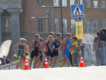 elite: STOCKHOLM - AUG 26, 2017: Group of running triathletes, Blummnefelt (NOR), Le Corre (FRA) and competitors in the Mens ITU World Triathlon series event August 26, 2017 in Stockholm, Sweden