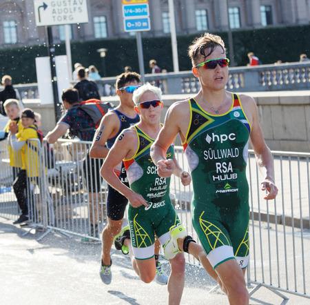 elite: STOCKHOLM - AUG 26, 2017: Running triathletes Wian Sullwald and Schoeman in the Mens ITU World Triathlon series event August 26, 2017 in Stockholm, Sweden