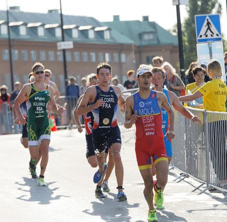 elite: STOCKHOLM - AUG 26, 2017: Running triathletes Mario Mola, Pierre Le Corre and competitors in the Mens ITU World Triathlon series event August 26, 2017 in Stockholm, Sweden Editorial