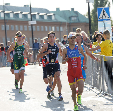 STOCKHOLM - AUG 26, 2017: Running triathletes Mario Mola, Pierre Le Corre and competitors in the Mens ITU World Triathlon series event August 26, 2017 in Stockholm, Sweden Editöryel