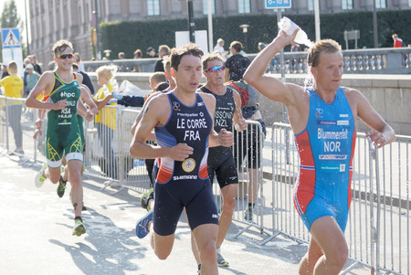elite: STOCKHOLM - AUG 26, 2017: Running triathletes Kristian Blummenfelt, Pierre Le Corre and competitors in the Mens ITU World Triathlon series event August 26, 2017 in Stockholm, Sweden Editorial