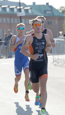 elite: STOCKHOLM - AUG 26, 2017: Group of running triathletes, Van Egdon (NED) and competitors in the Mens ITU World Triathlon series event August 26, 2017 in Stockholm, Sweden Editorial