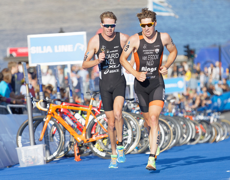 elite: STOCKHOLM - AUG 26, 2017: Running triathletes Van Egdom and Ward at the finish of the race in the Mens ITU World Triathlon series event August 26, 2017 in Stockholm, Sweden Editorial