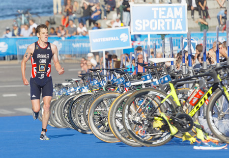 elite: STOCKHOLM - AUG 26, 2017: Running triathlete Jonathan Brownlee on the finish where the bicycles are parked in the Mens ITU World Triathlon series event August 26, 2017 in Stockholm, Sweden
