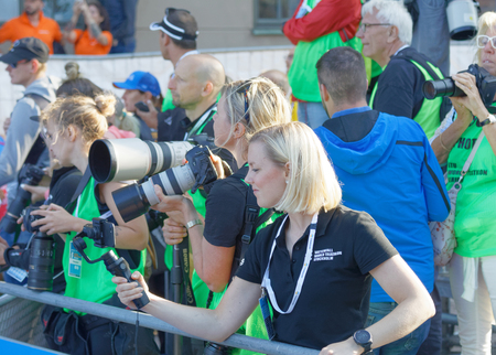 elite: STOCKHOLM - AUG 26, 2017: Professional photografers taking photos  the finish of the triathlon race in the Mens ITU World Triathlon series event August 26, 2017 in Stockholm, Sweden