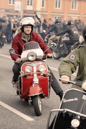 STOCKHOLM, SWEDEN - SEPT 02, 2017: Mods wearing old fashioned clothes driving old fashioned vespa scooter at the Mods vs Rockers event at the Saint Eriks bridge, Stockholm, Sweden, September 02, 2017