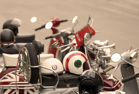 STOCKHOLM, SWEDEN - SEPT 02, 2017: Retro MC helmets on old fashioned vespa scooter and other scooters in the background at the Mods vs Rockers event at the Saint Eriks bridge, Stockholm, Sweden, September 02, 2017