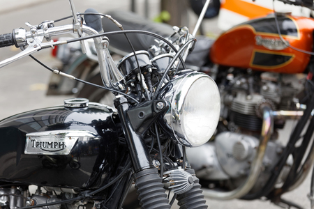 STOCKHOLM, SWEDEN - SEPT 02, 2017: Closeup of shiny black retro motorcycle at the Mods vs Rockers event at the Saint Eriks bridge, Stockholm, Sweden, September 02, 2017