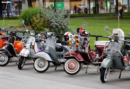 STOCKHOLM, SWEDEN - SEPT 02, 2017: Closeup of  wheels of parkedcolorful red, orange and black old fashioned vespa scooters  at the Mods vs Rockers event at the Saint Eriks bridge, Stockholm, Sweden, September 02, 2017