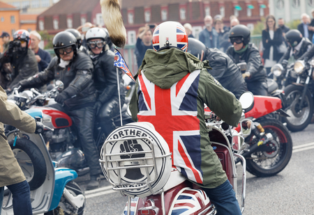 STOCKHOLM, SWEDEN - SEPT 02, 2017: Mods wearing uk flag and rockers wearing leather clothes driving retro vespa scooters and mc at the Mods vs Rockers event at the Saint Eriks bridge, Stockholm, Sweden, September 02, 2017