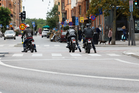 tough: STOCKHOLM, SWEDEN - SEPT 02, 2017: Back of three mc drivers in leather clothes on retro motorcycles at the Mods vs Rockers event at the Saint Eriks bridge, Stockholm, Sweden, September 02, 2017