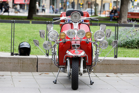 STOCKHOLM, SWEDEN - SEPT 02, 2017: Lots of lamps on a modified old fashioned classic vespa scooter  at the Mods vs Rockers event at the Saint Eriks bridge, Stockholm, Sweden, September 02, 2017 Editorial