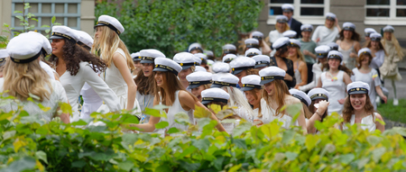 STOCKHOLM, SWEDEN - JUN 13, 2017: Smiling students wearing white graduation caps after graduation at the dance school Balettakademien, June 13, 2017,Stockholm,Sweden