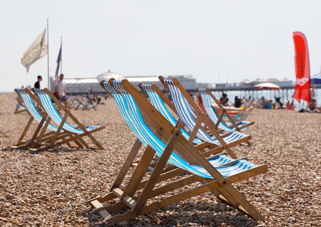 BRIGHTON, GREAT BRITAIN   JUN 17, 2017: Closeup Of Classic Deckchairs And  People