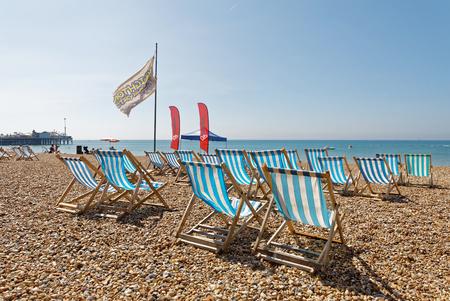 BRIGHTON, GREAT BRITAIN   JUN 17, 2017: Classic Deckchairs On The Pebble  Beach