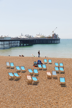 BRIGHTON, GREAT BRITAIN   JUN 17, 2017: Classic Deckchairs On The Pebble  Beach