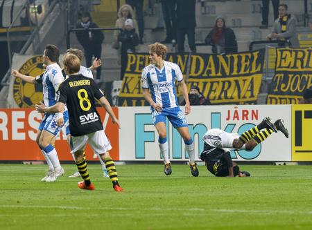 SOLNA SWEDEN - OCT 30, 2017: Soccer player Henok Goiom (AIK) getting folded. October 30 2017,Solna,Sweden