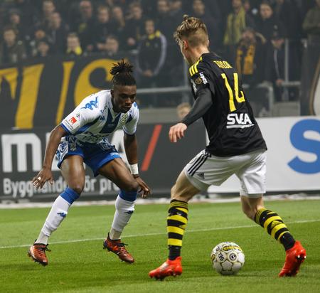 SOLNA SWEDEN - OCT 30, 2017: Soccer player Robert Taylor (AIK) dribble to pass Sam Adekube (IFK Goteborg). October 30 2017,Solna,Sweden