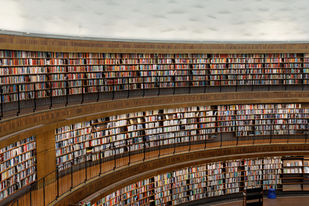 STOCKHOLM, OCT 30 2017: Entrance of the city library in Stockholm called Stadsbiblioteket, the beautiful central rotunda and lots of books in shelfs. October 30, 2017, Stockholm, Sweden. Editorial