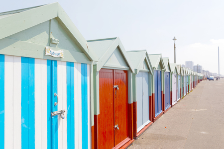 BRIGHTON, GREAT BRITAIN - JUN 19, 2017: Lots of very colorful bathing huts in Brighton and Hove. No people and blue sky. June 19, 2017 in Brighton, Great Britain