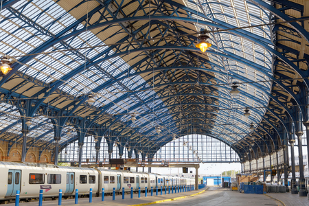 BRIGHTON, GREAT BRITAIN - JUN 19, 2017: The beautiful train station in Brighton, UK made of steel painted in blue. June 27, 2017 in Brighton, Great Britain Editoriali