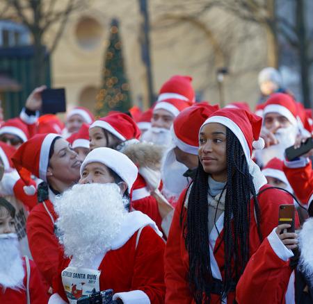 STOCKHOLM, SWEDEN - DEC 10, 2017: Many Santas in traditional red dresses and beard in the Stockholm Santa Run in Sweden, December 10, 2017