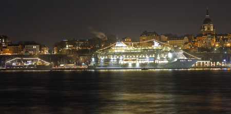 STOCKHOLM, SWEDEN - DEC 27, 2017: Nightscape of a large ferry and beautful architecture in central Stockholm in Sweden, December 27, 2017 Editorial