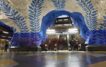 STOCKHOLM, SWEDEN - FEB 27, 2018: Motion blurred people walking in the underground subway station T-Centralen, escalator in the background in Stockholm, Sweden, February 27, 2018 Sajtókép