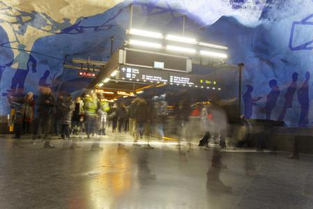 STOCKHOLM, SWEDEN - FEB 27, 2018: Stressed motion blurred people walking in the underground subway station T-Centralen, escalator in the background in Stockholm, Sweden, February 27, 2018 Sajtókép