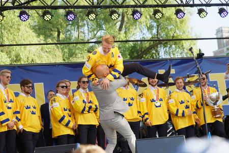 STOCKHOLM, SWEDEN - MAY 21, 2018: Swedish ice hockey players winning the World Championship, getting celebrated in Kungstradgarden, Stockholm, Sweden. In Kungstradgarden, Stockholm, Sweden, May 21, 2018
