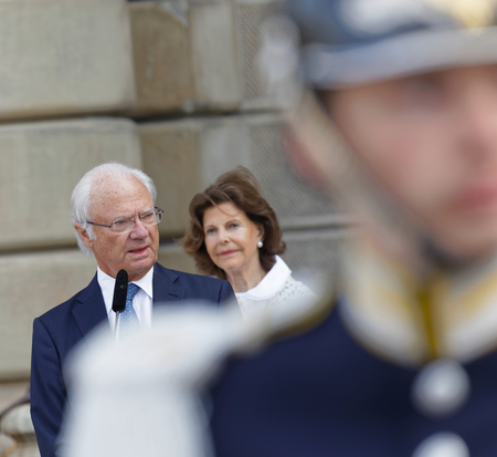 STOCKHOLM, SWEDEN - JUN 06, 2018: The swedish king Carl Gustaf Bernadotte XVI giving a speech, his queen Silvia in the background celebrating the swedish national day June 06 in Stockholm