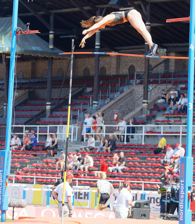 STOCKHOLM, SWEDEN - JUN 10, 2018: Iryna Zhuk (Belarus) jumping in the Pole Vault competition in IAAF Diamond League Bauhaus galan, June 10, 2018 in Stockholm, Sweden