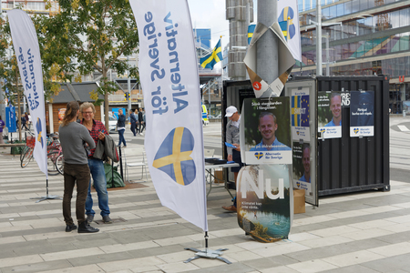 STOCKHOLM, SWEDEN - AUG 26, 2018: Political partys at their polling huts trying to get votes during the election campaign, August 26, 2018 in central Stockholm, Sweden Sajtókép
