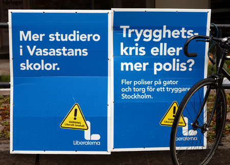 STOCKHOLM, SWEDEN - AUG 27, 2018: Political party posters from the right wing party Liberalerna  trying to get votes during the election campaign. Sweden, August 27, 2018 in central Stockholm, Sweden