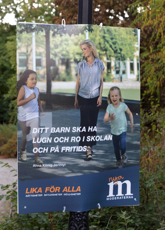 STOCKHOLM, SWEDEN - AUG 27, 2018: Political party posters from the right wing party Moderaterna  trying to get votes during the election campaign. Sweden, August 27, 2018 in central Stockholm, Sweden