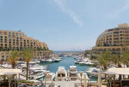 VALETTA, MALTA - JUN 18 2018: The harbor Portomaso Marina, St Julien's close to Valetta where many luxury motor boats lay. Valetta, Malta June 18, 2018