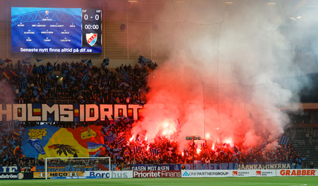 STOCKHOLM, SWEDEN - MAR 10, 2019: Supporters and smoke from Bengal pyrotechnics at the derby Swedish soccer cup quarter finals between Djurgarden vs Hammarby. March 10 2019,Stockholm,Sweden